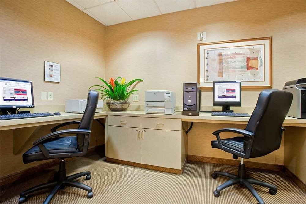 desk office property chair building home living room waiting room