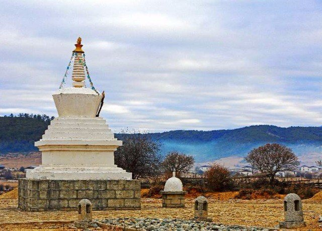 sky building place of worship historic site landmark tower temple stupa monastery chapel monument stone pasture