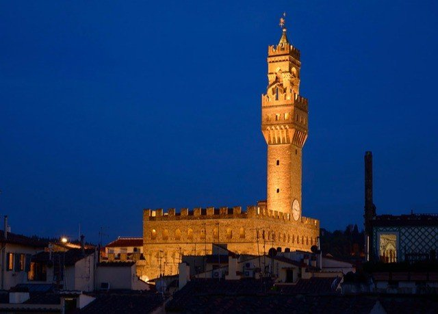 sky building landmark night tower evening dusk cityscape place of worship mosque clock tower