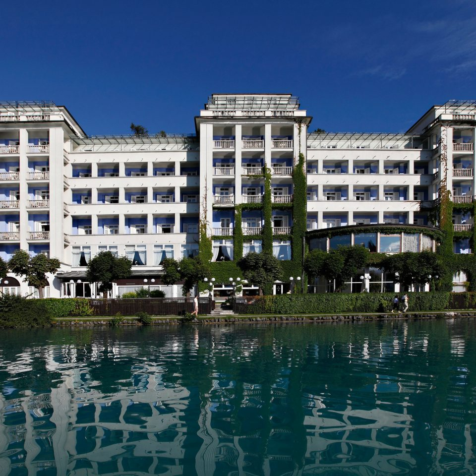 sky building water marina dock condominium cityscape residential area tower block palace waterway skyline