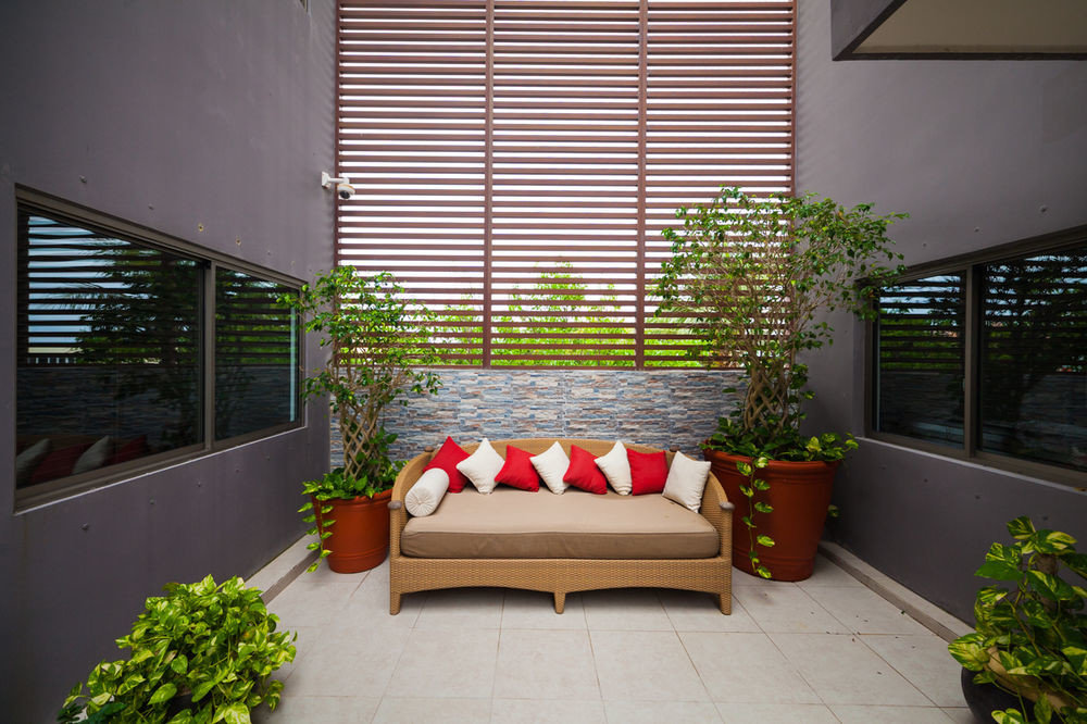 plant property building house condominium living room home porch outdoor structure window blind window treatment