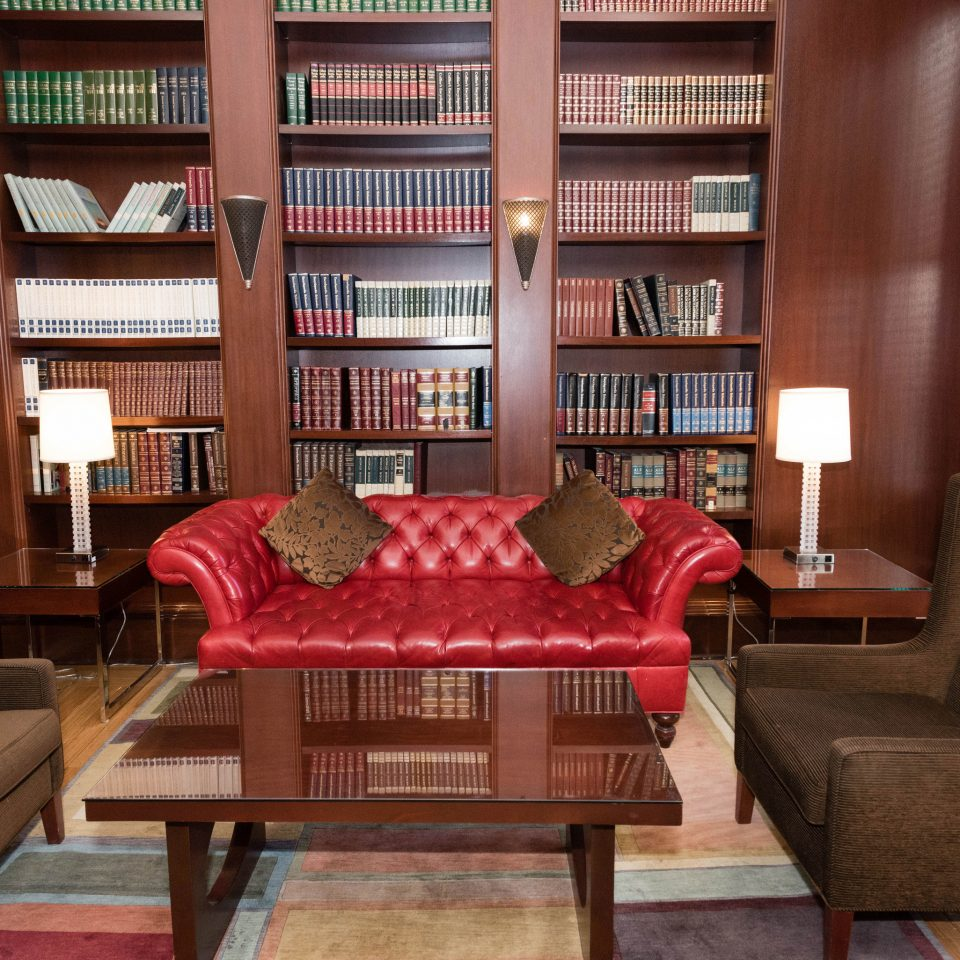 library living room property building home red shelf condominium leather