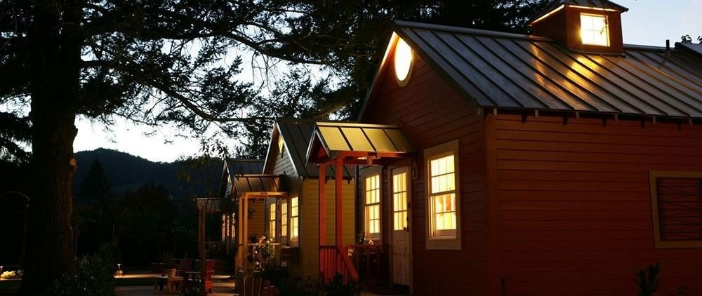 tree house building night home evening lighting cottage outdoor structure residential
