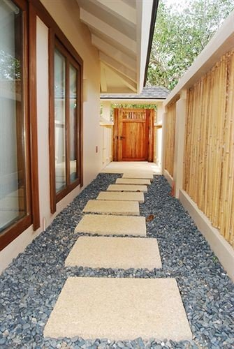 property building hardwood home flooring cottage outdoor structure porch wood flooring stone