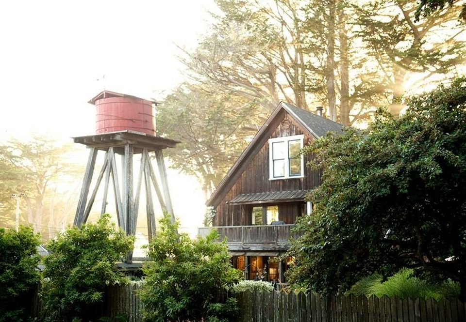 tree property house building home cottage tower mansion outdoor structure outdoor object wooded