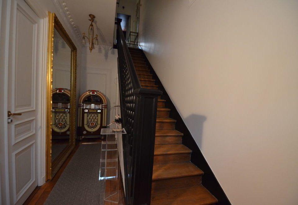 stairs property building house hardwood home hall flooring wood flooring handrail step