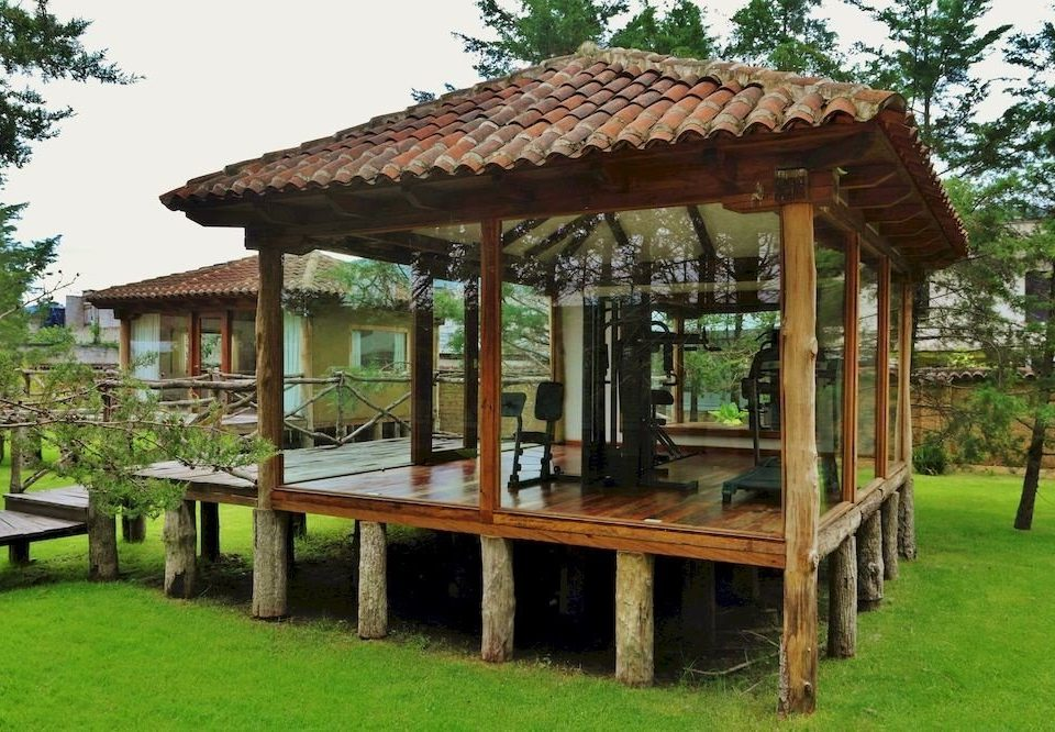 grass tree sky building gazebo wooden pergola outdoor structure house pavilion lush