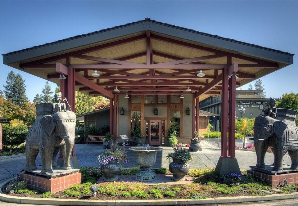 sky building house gazebo shinto shrine shrine outdoor structure pavilion statue temple porch