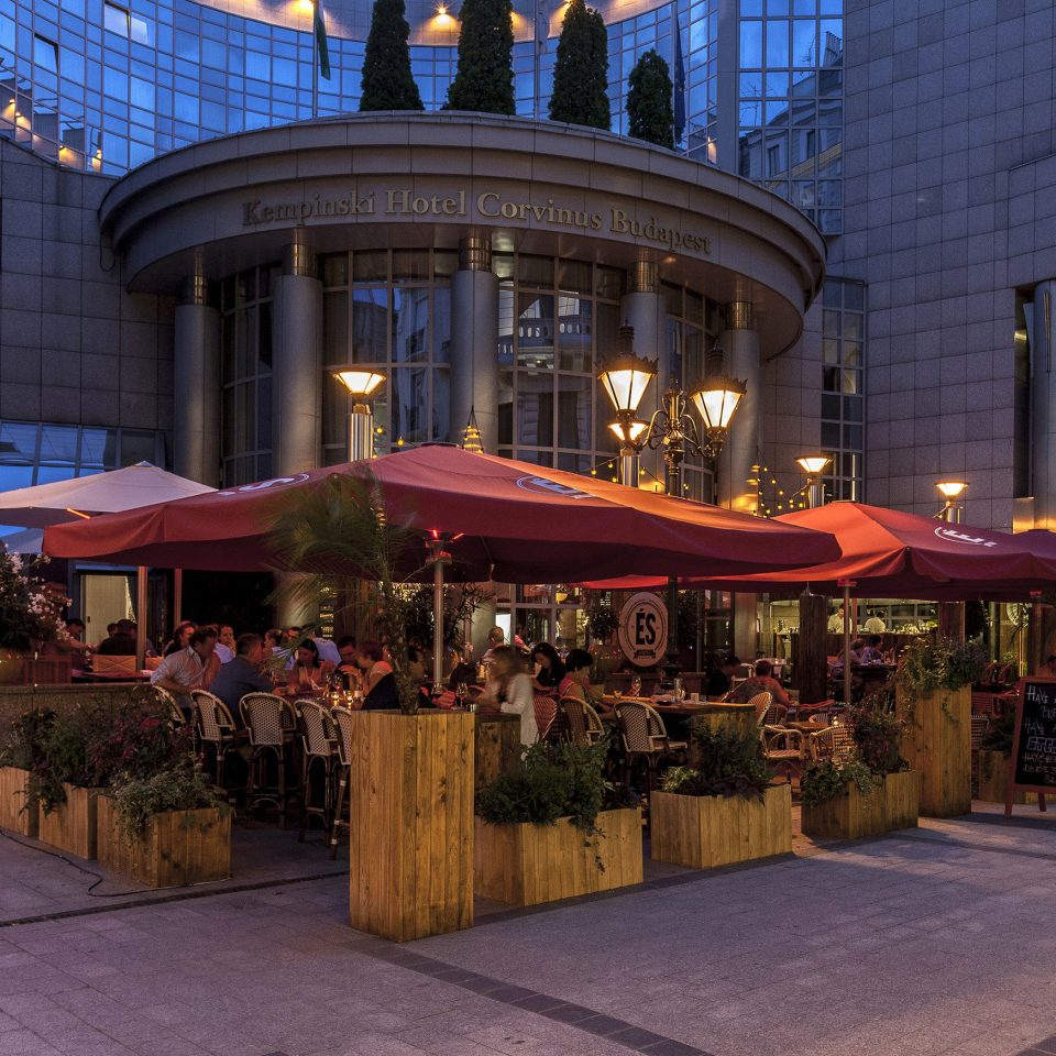 Buildings City Dining Eat Exterior Outdoors building Town road public space plaza night Downtown street evening shopping mall restaurant market shopping
