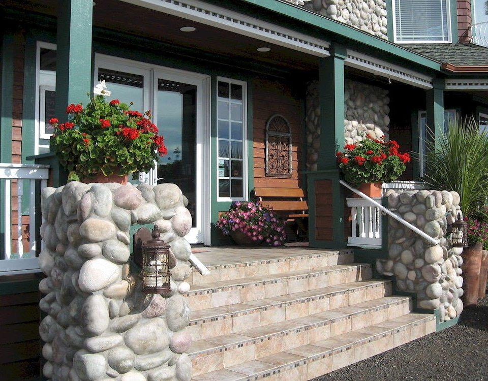 Buildings Exterior Garden Grounds Inn building property home walkway Courtyard porch stone yard cottage outdoor structure backyard