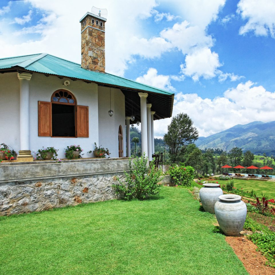 Buildings Cultural Exterior Grounds Outdoors Rustic grass sky property house building home residential area Villa cottage rural area farmhouse Village lawn Farm mansion grassy