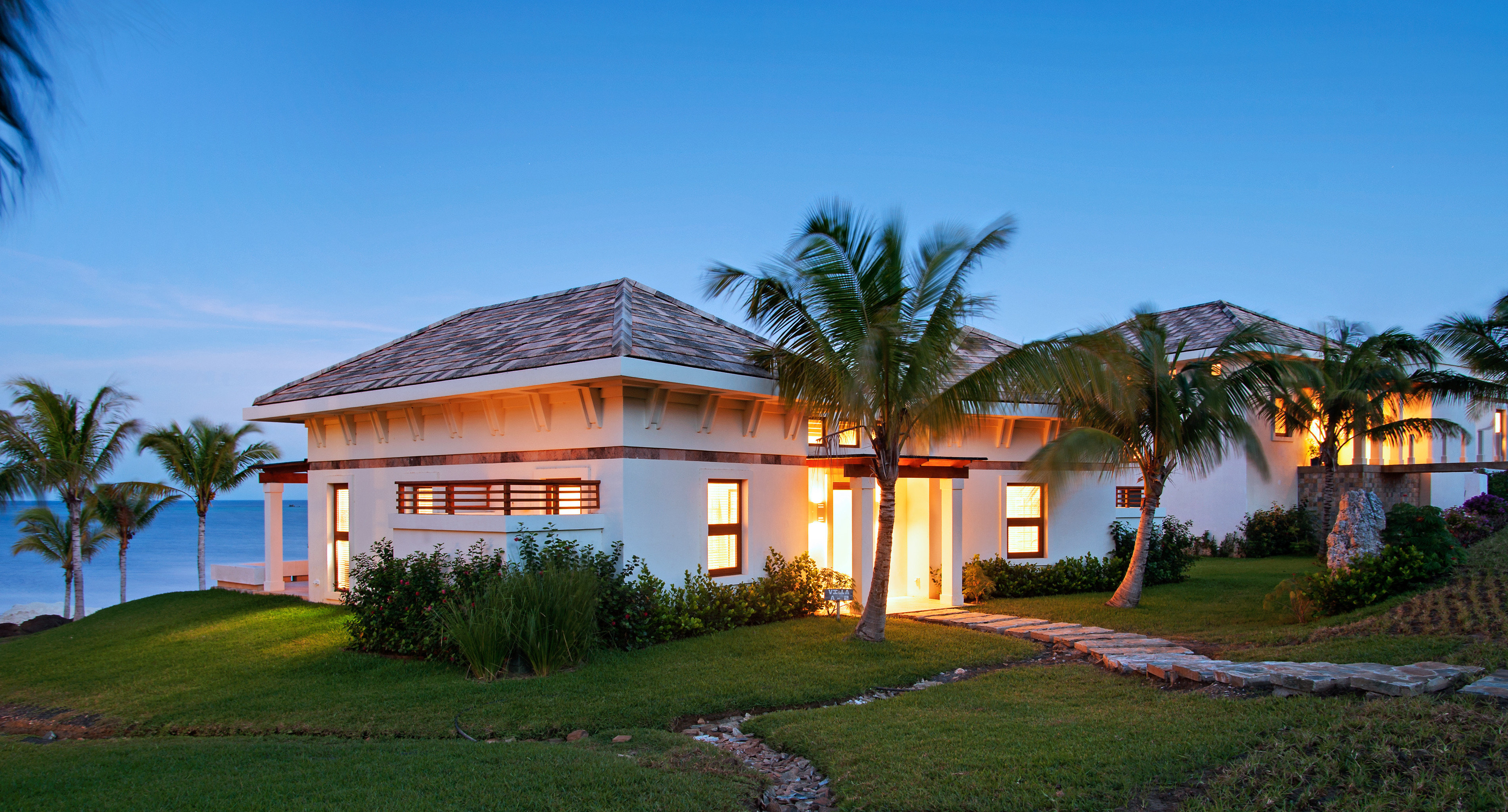 Buildings Eco Exterior Grounds Island Romance Scenic views Sunset Villa Waterfront grass sky house tree building property home Resort residential area residential mansion cottage grassy lush