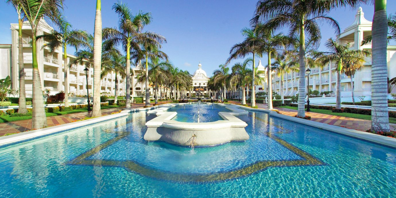 Buildings Elegant Exterior Lounge Luxury Modern Pool tree sky Resort water swimming pool property leisure building palm condominium resort town caribbean Villa Water park Lagoon mansion swimming