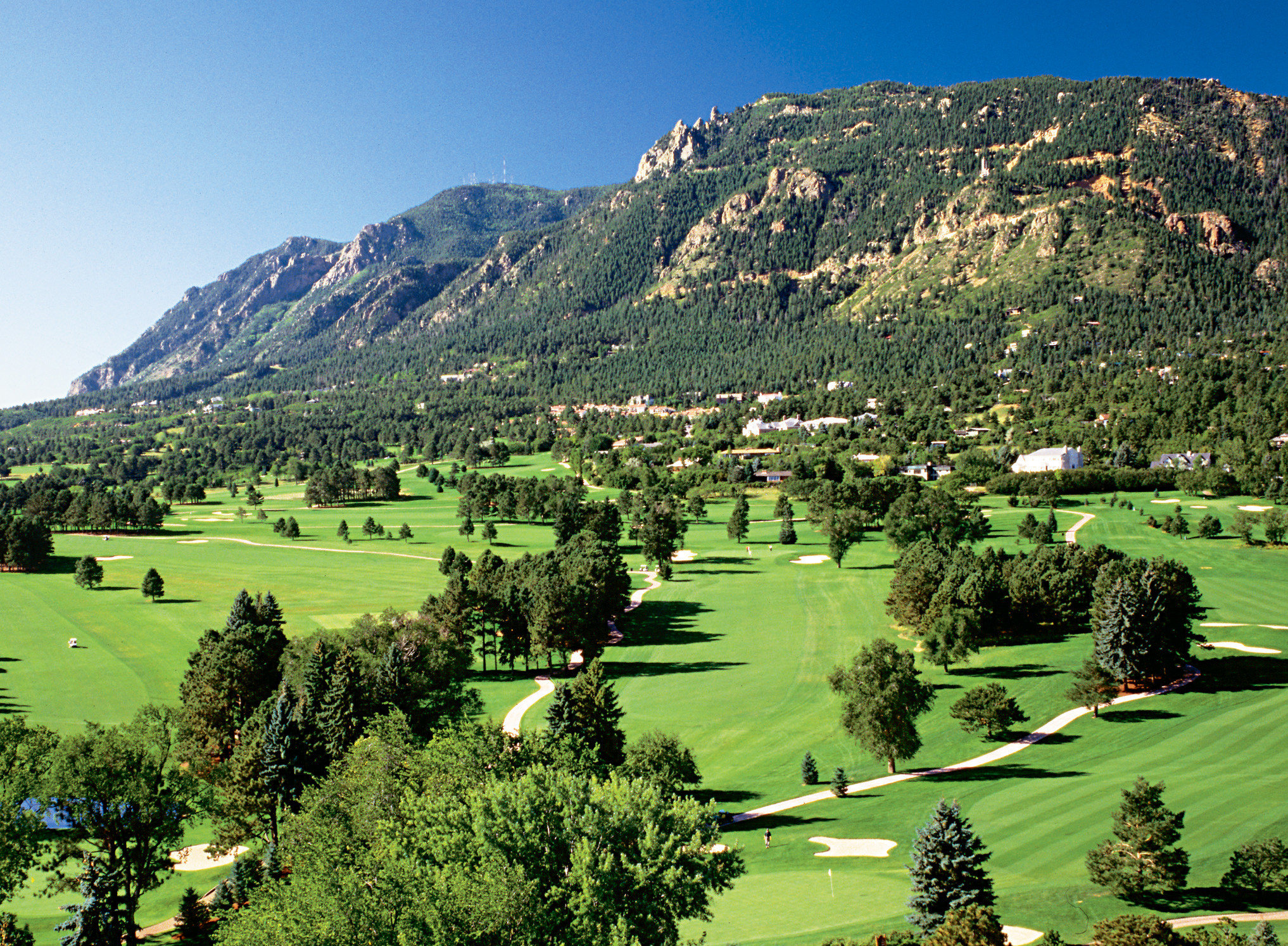 Buildings Exterior Grounds Mountains Outdoors Resort Scenic views mountain sky grass mountainous landforms Nature structure sport venue aerial photography green mountain range golf course hill sports rural area landscape valley Golf golf club plateau lush overlooking hillside highland