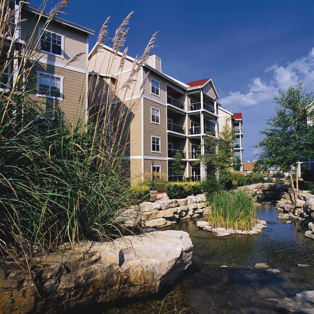 Buildings Exterior Grounds Parks building sky property rock house stone residential area home old cottage waterway castle apartment building surrounded