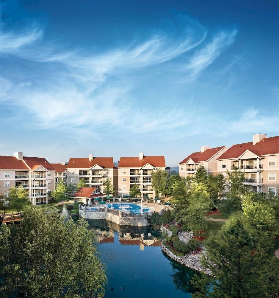 Buildings Exterior Grounds Parks tree sky property Town residential area house Resort cityscape condominium