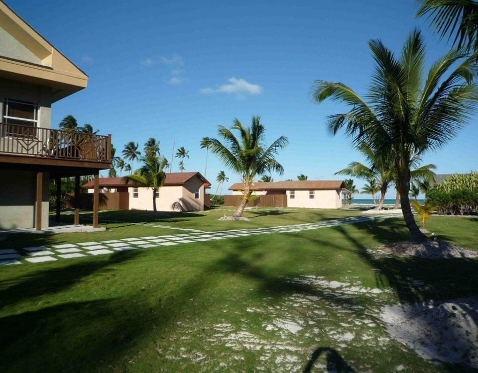 Buildings Exterior Grounds sky grass tree property home Villa house residential area Resort mansion palm plant