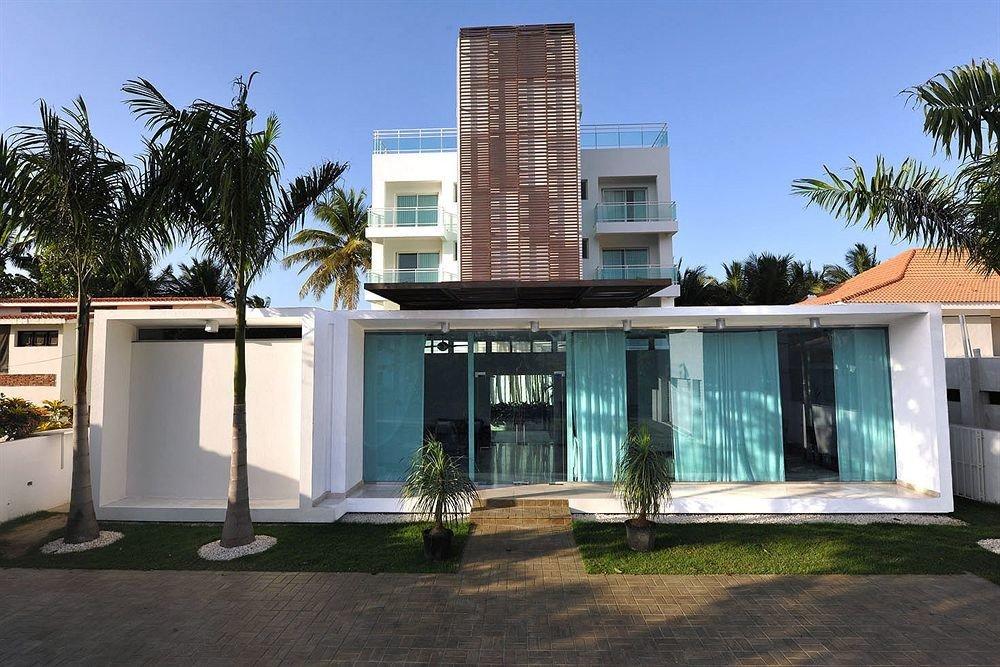 Buildings Exterior Landmarks tree sky property condominium building home house residential area Villa Resort palm