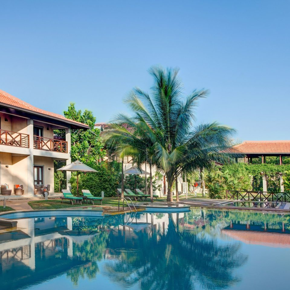 Buildings Exterior Lounge Pool sky building tree water house leisure property swimming pool Resort resort town home condominium palace Villa