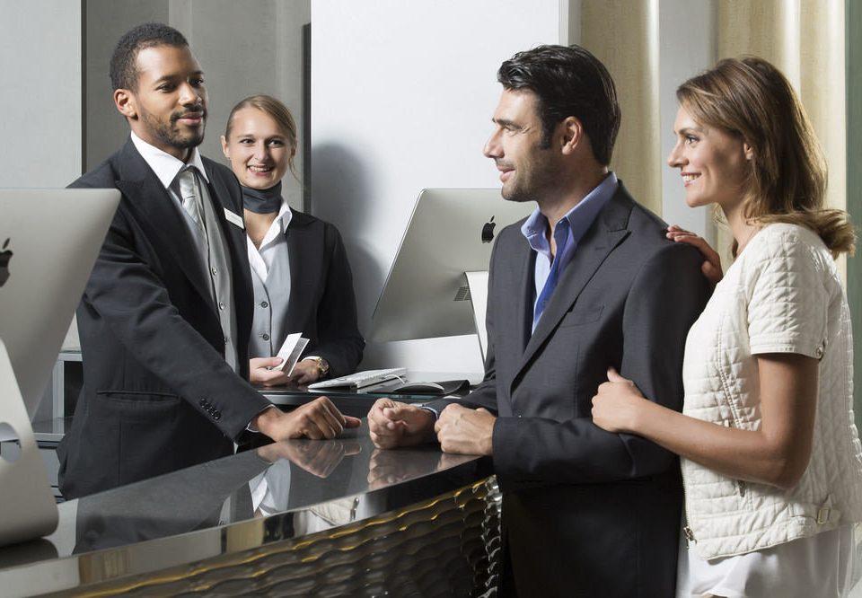 man suit standing business executive formal wear Business businessperson technology tuxedo white collar worker professional public relations service financial adviser dressed necktie