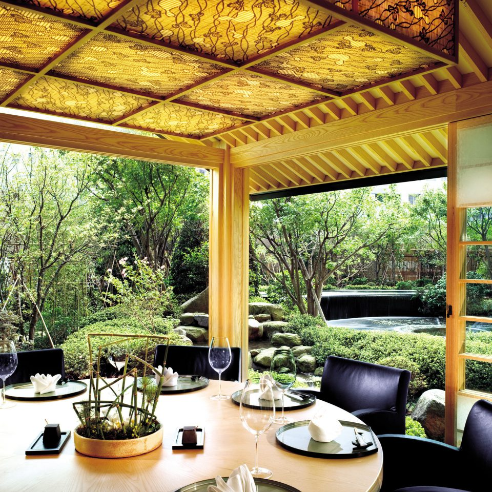 Business City Dining Drink Eat Garden Grounds Luxury Modern property Resort home restaurant condominium porch living room Villa Lobby mansion backyard outdoor structure dining table