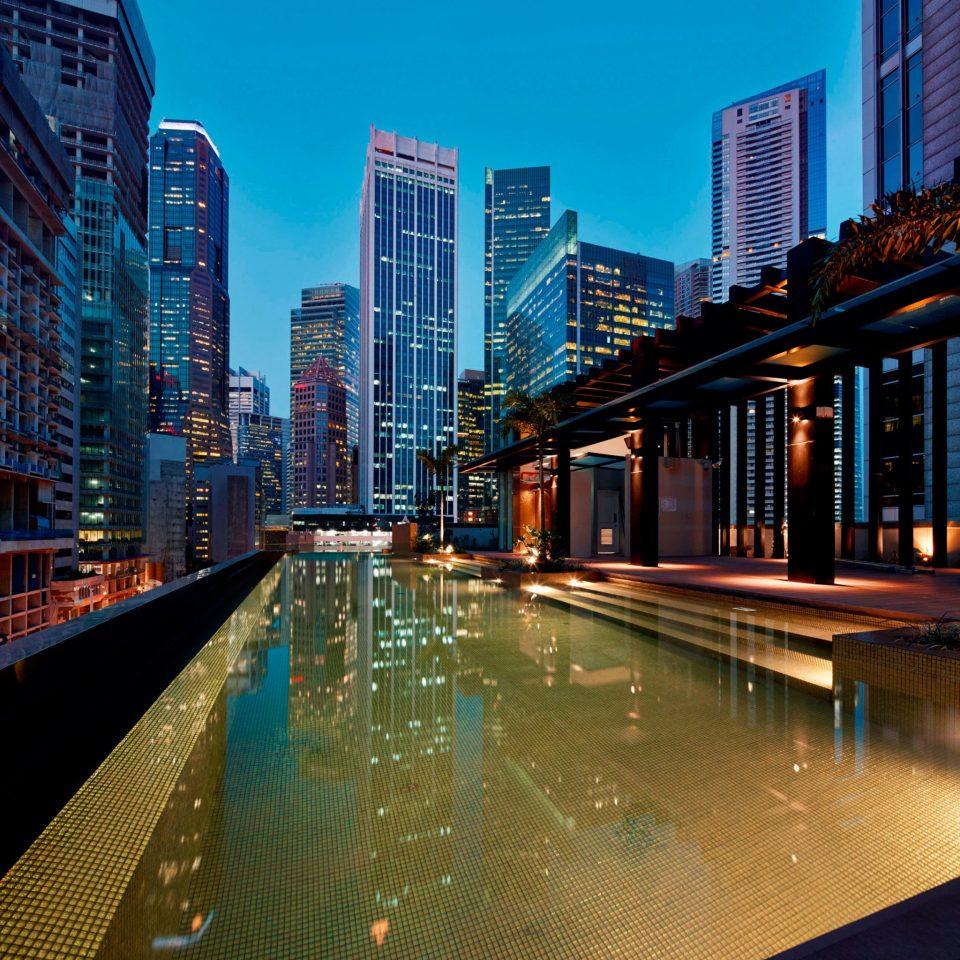 Business City Luxury Modern Pool Rooftop building metropolitan area condominium cityscape metropolis night Downtown skyscraper skyline evening