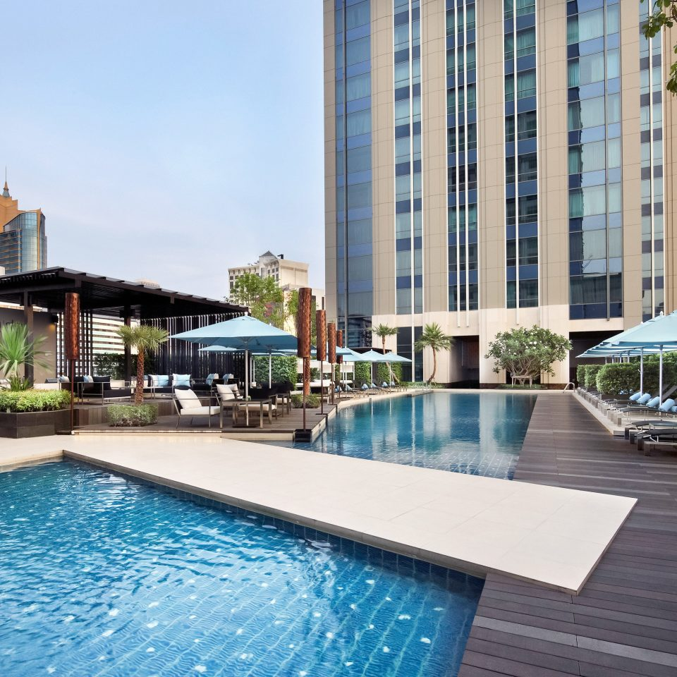 Business City Grounds Landmarks Modern Pool Rooftop Scenic views building condominium swimming pool property reflecting pool Resort Villa home backyard swimming