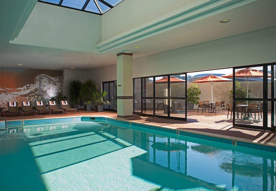 Business City Hip Pool swimming pool building property leisure green condominium Resort leisure centre blue