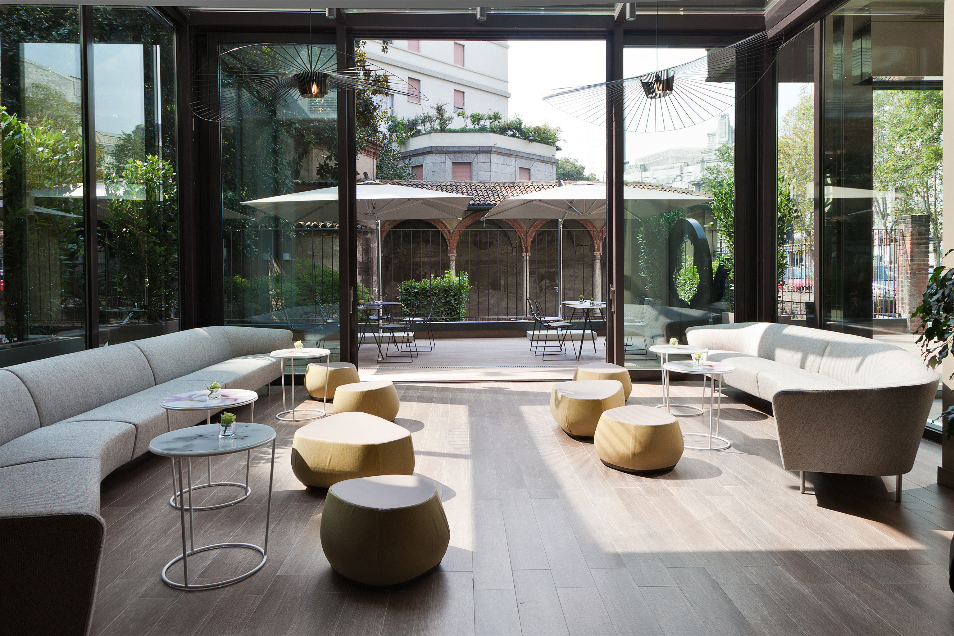 Business Lounge Modern property condominium living room outdoor structure home porch Lobby Courtyard backyard Patio orangery Villa overlooking stone