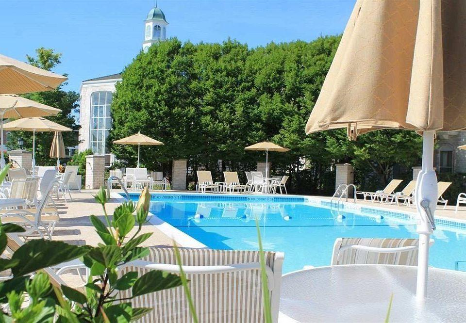 Business Family Pool chair swimming pool property leisure Resort building Villa condominium blue lawn caribbean mansion backyard