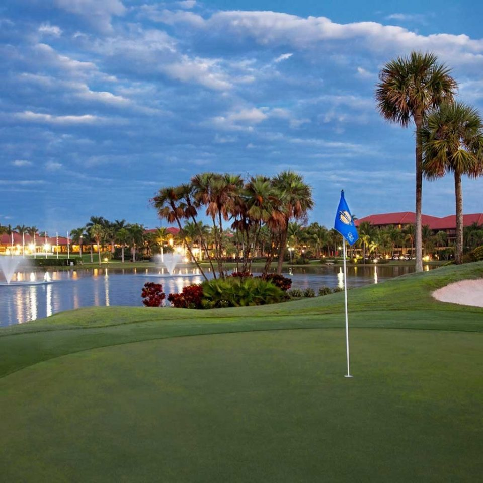Business Golf Grounds Outdoors Resort Sport sky grass structure tree sport venue outdoor recreation golf course arecales recreation sports park lawn day