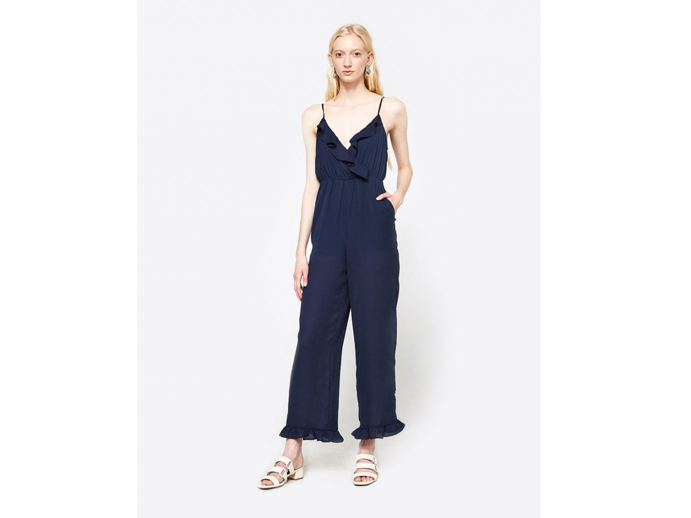 City Palm Springs Style + Design Travel Shop clothing shoulder standing dress fashion model neck posing electric blue formal wear overall joint one piece garment waist trouser suit work-clothing