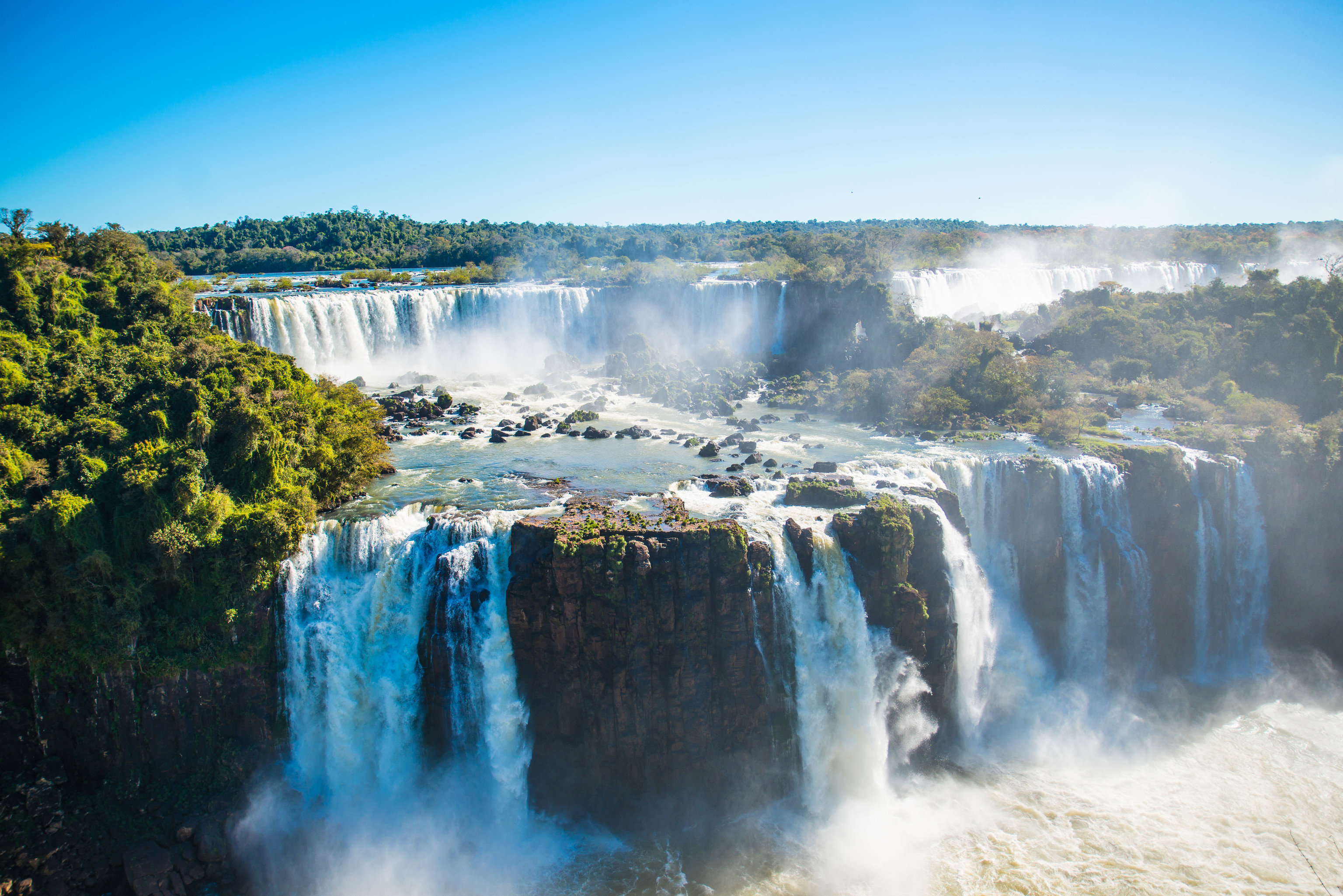 Boutique Hotels Hotels Luxury Travel National Parks Trip Ideas sky Nature Waterfall outdoor water body of water atmospheric phenomenon water feature River wasserfall reflection landscape