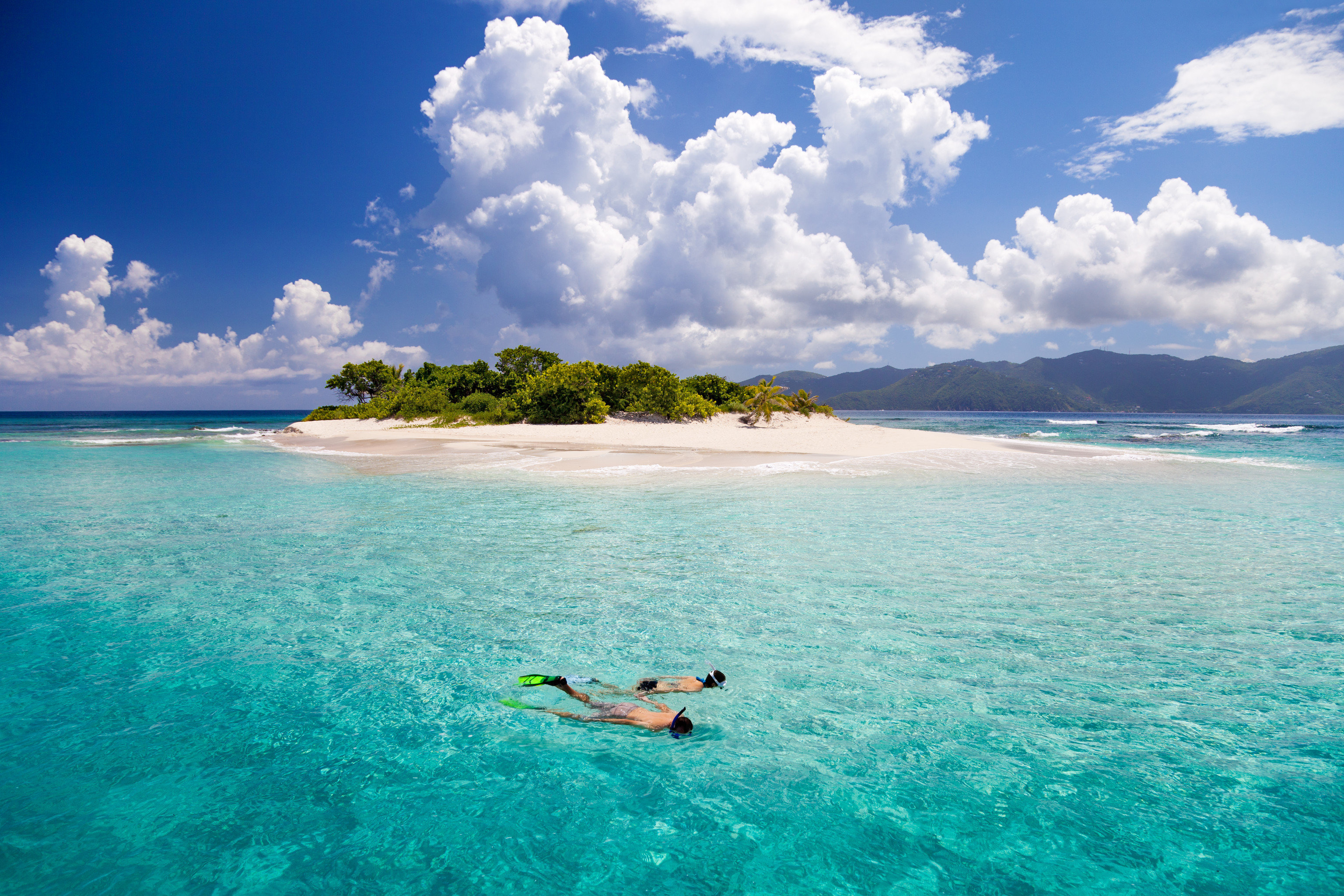 water sky outdoor Ocean Sea water sport caribbean reef cloud horizon vacation Beach islet Nature Island archipelago Coast Lagoon bay tropics cape wave blue cloudy clouds day swimming