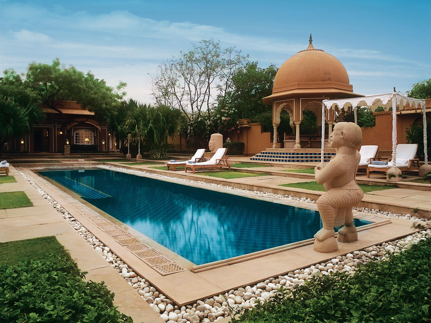 Hotels Luxury Travel Trip Ideas sky outdoor tree building swimming pool property leisure water estate Villa real estate Resort reflection resort town hacienda recreation tourism thermae amenity landscape vacation
