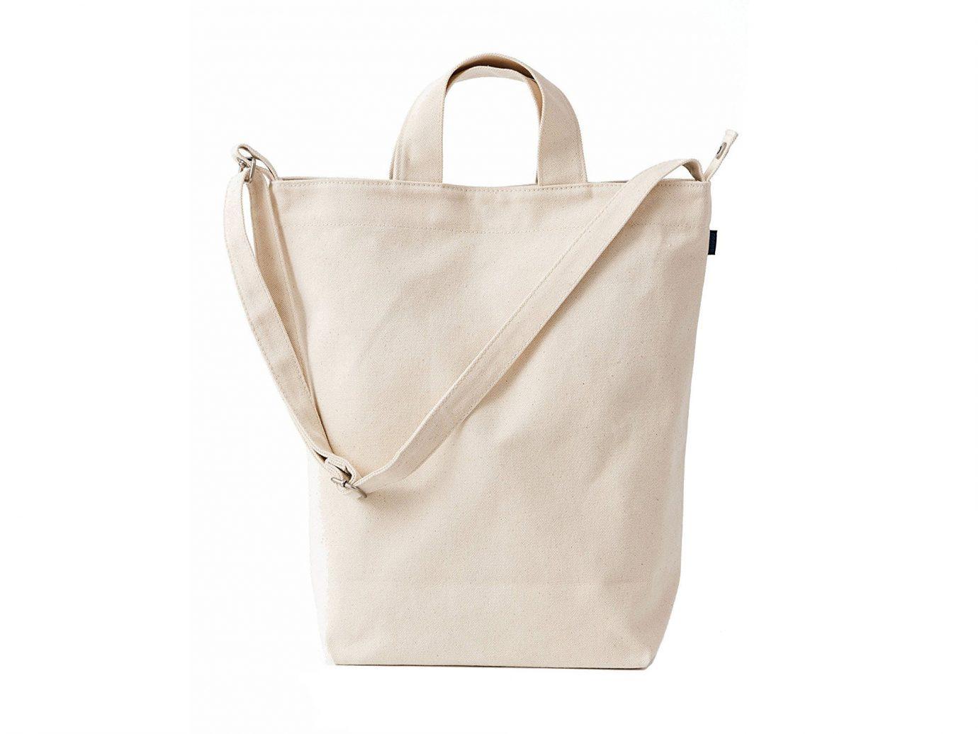 Packing Tips Style + Design Travel Shop Weekend Getaways white accessory bag handbag shoulder bag beige product case product design