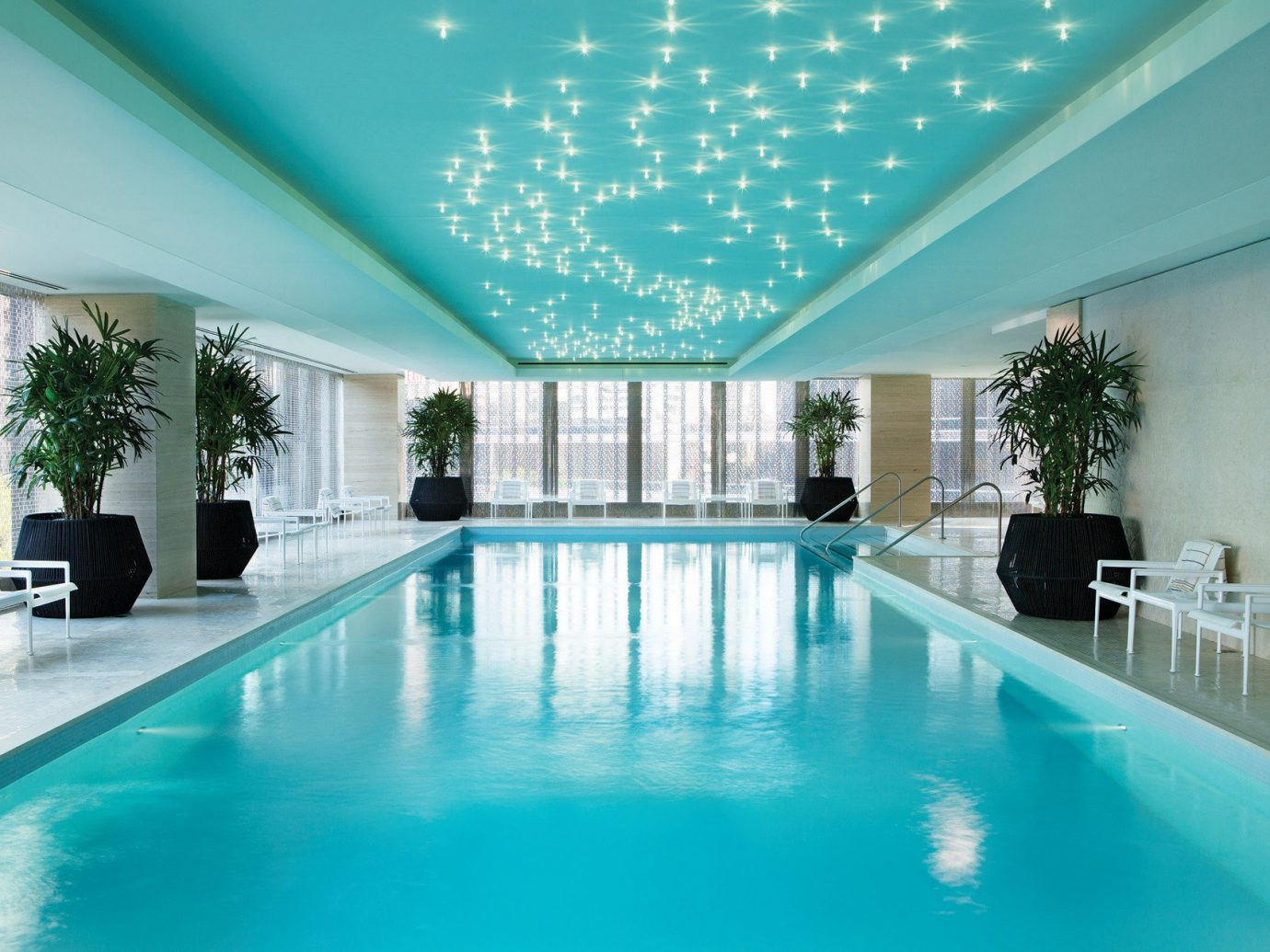 Hotels water Pool indoor floor ceiling swimming pool property room building Resort estate blue leisure centre condominium interior design mansion swimming real estate Villa Dining furniture