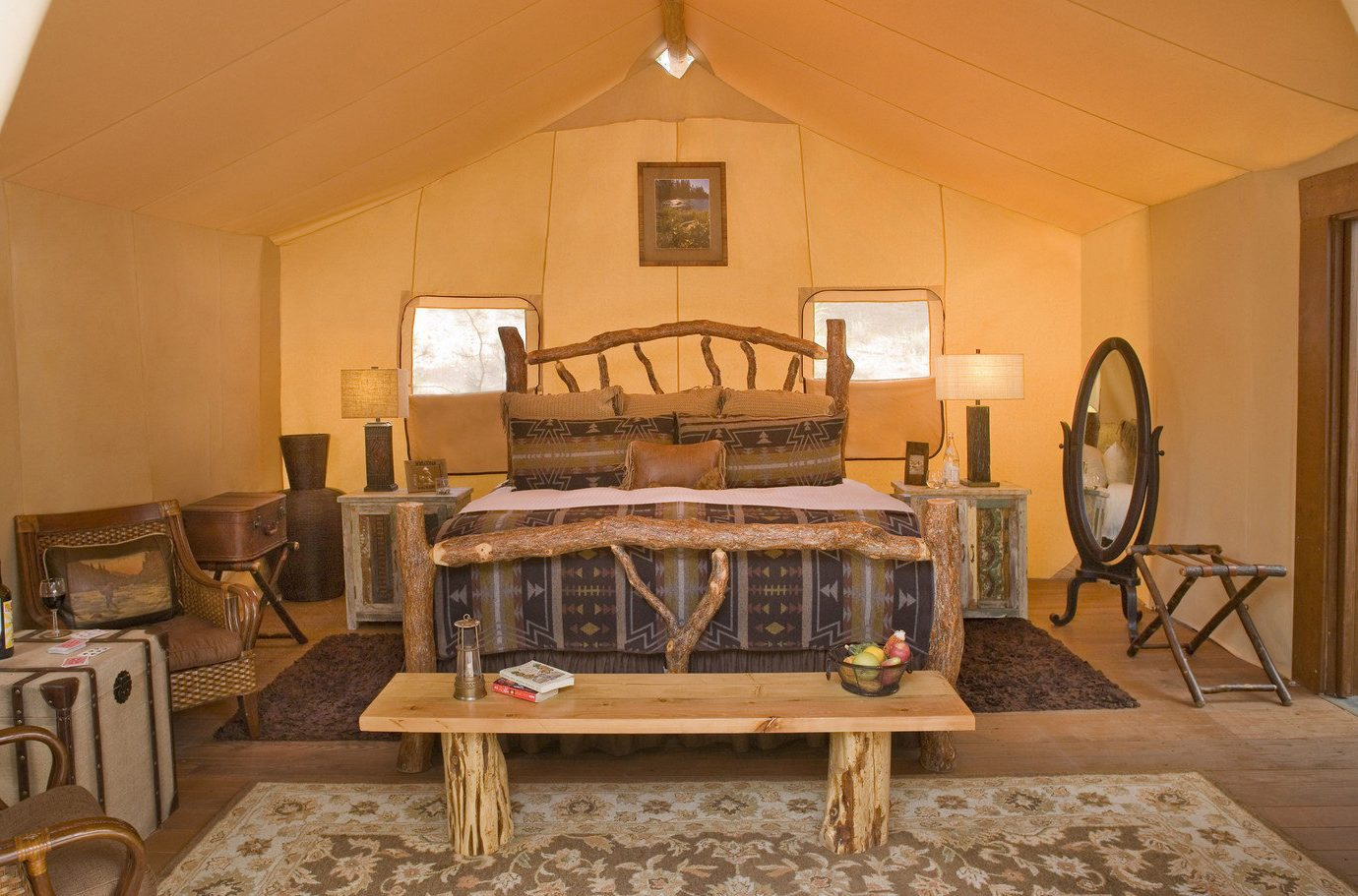 Bedroom Glamping Luxury Nature Outdoors Outdoors + Adventure remote Road Trips Rustic tent tents Trip Ideas Weekend Getaways wilderness wall indoor floor ceiling room property Living living room estate home furniture cottage interior design wooden dining room Villa farmhouse mansion wood real estate Suite area