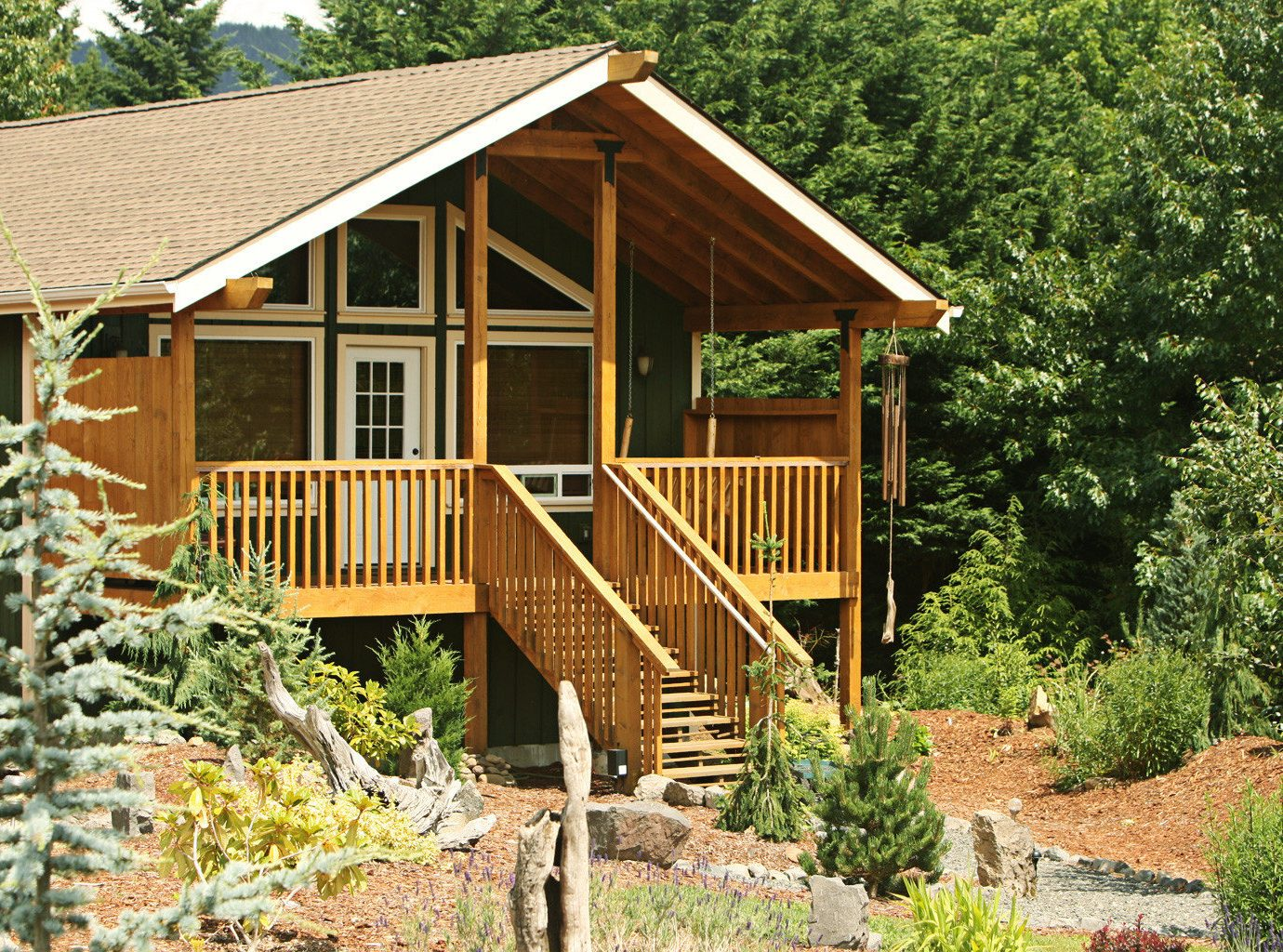 Cabin Exterior tree house building wooden log cabin rock shed yellow outdoor structure cottage Garden home backyard hut bushes surrounded