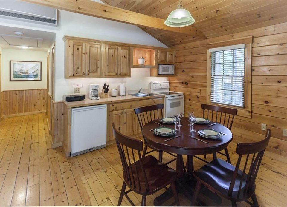 Cabin Kitchen Lodge property cottage wooden home hardwood vehicle yacht cabinetry farmhouse wood flooring hard Island