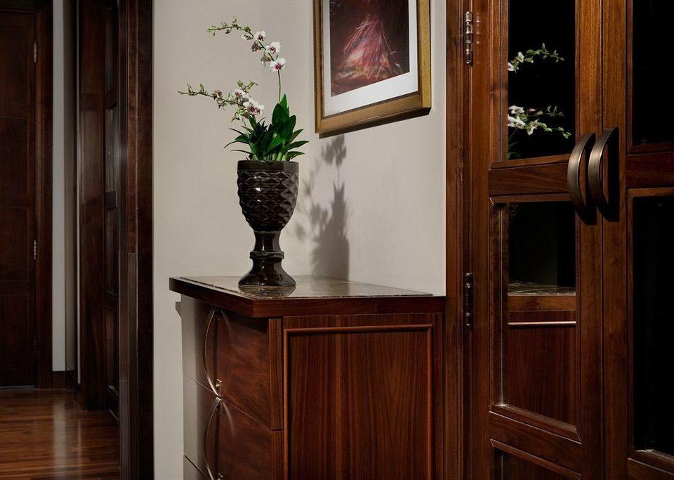 cabinet cabinetry home hardwood house lighting wood flooring shelf hall flooring door