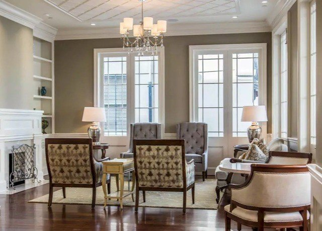 living room property chair home hardwood condominium flooring wood flooring cabinetry farmhouse cottage dining table