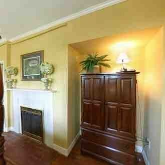 property cabinetry living room hardwood home cottage wood flooring molding mansion hard