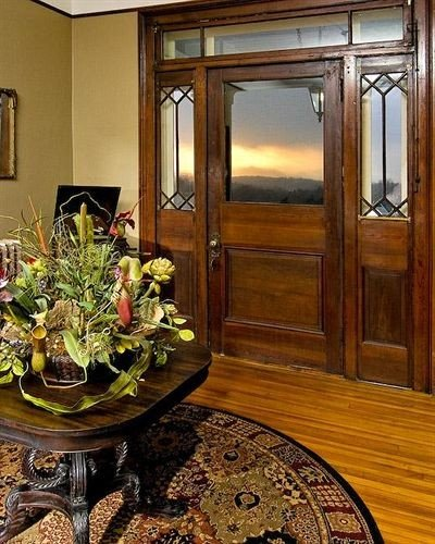 home hardwood floristry cabinetry living room flooring mansion plant dining table