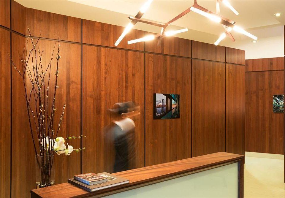 cabinetry wooden lighting receptionist door