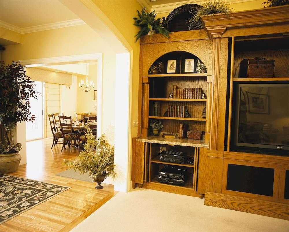 property living room home cabinetry hardwood mansion hall entertainment center