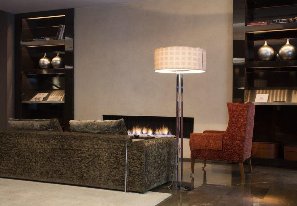 living room cabinetry hardwood lighting hearth wood flooring