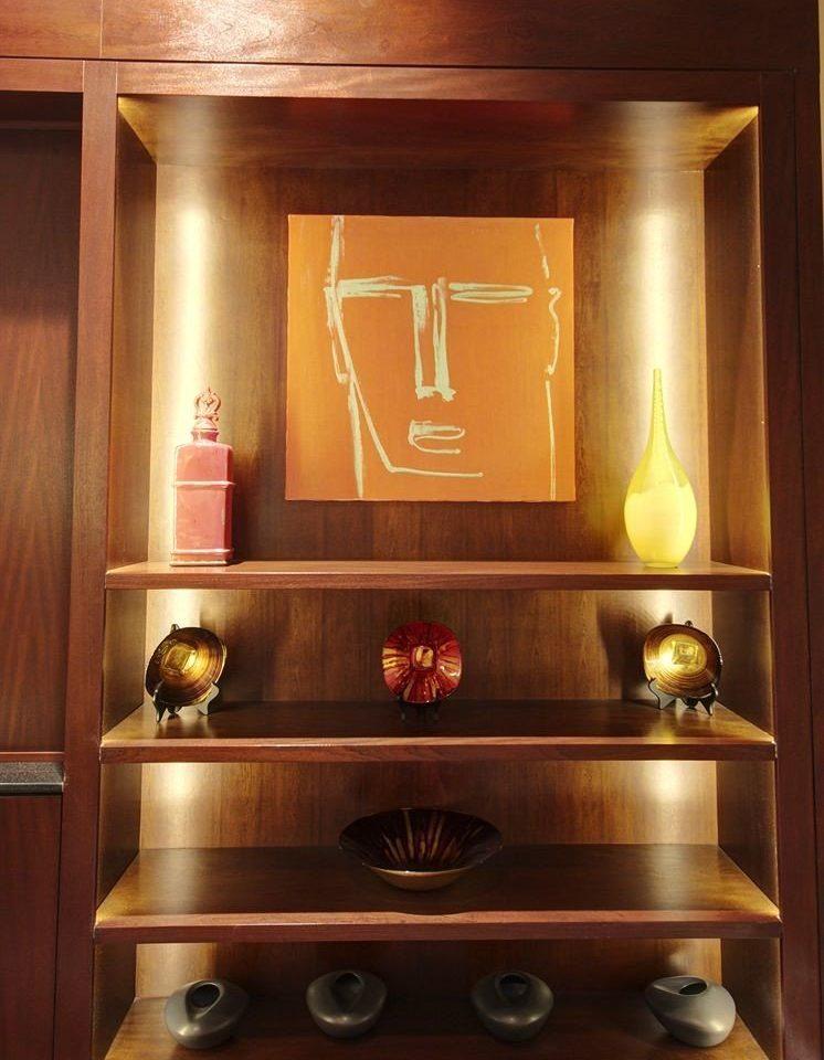 man made object cabinetry wooden lighting shelf oven stainless steel range hood