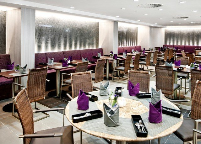 chair restaurant function hall conference hall purple convention center cafeteria dining table