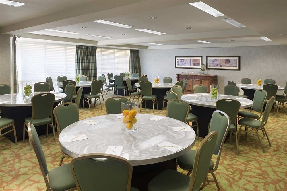 chair property conference hall restaurant function hall waiting room cafeteria meeting convention center dining table